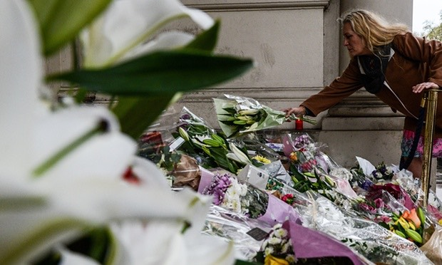 Pic 1. Members of the public lay flowers on the steps of the French embassy in London. Photograph, Chris Ratcliffe/Getty Images