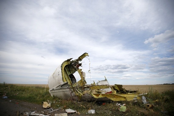 Pic 1. Part of the wreckage from Malaysia Airlines Flight MH17, in the Donetsk region of Ukraine (Maxim Zmeyev_Reuters), lead