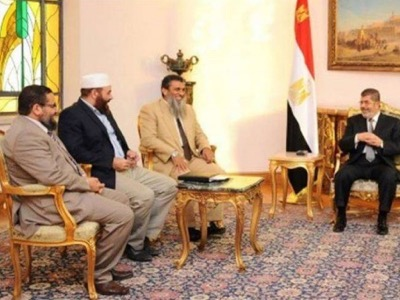 Pic 3. Morsi celebrated 6 Oct , the day of President Sadat assassination, Morsi with late president Sadat's assassins in Etihadeya presidential palace